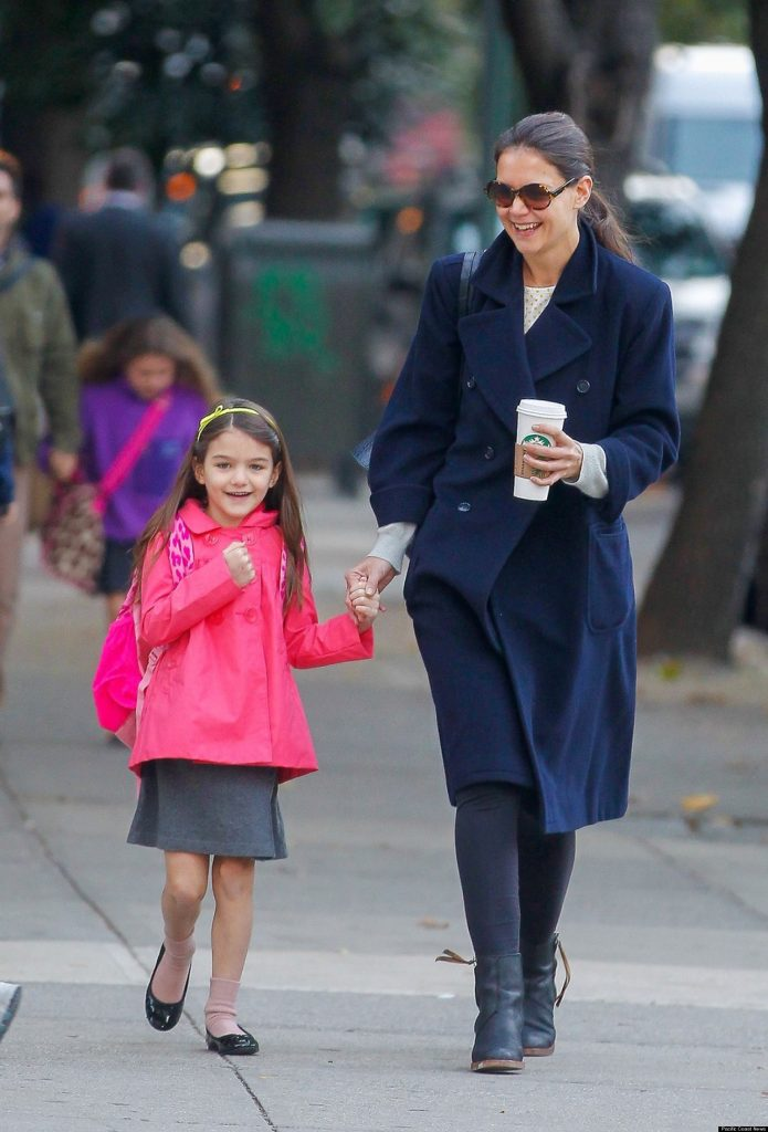 85922, NEW YORK, NEW YORK - Monday October 22, 2012. Actress Katie Holmes seen in high spirits, make up free and carrying a large coffee while sharing a joke with daughter Suri on the way to school in New York. ***BRAZIL OUT*** Photograph: ©Wagner Az, PacificCoastNews.com **FEE MUST BE AGREED PRIOR TO USAGE** **E-TABLET/IPAD & MOBILE PHONE APP PUBLISHING REQUIRES ADDITIONAL FEES** LOS ANGELES OFFICE:+1 310 822 0419 LONDON OFFICE:+44 20 8090 4079
